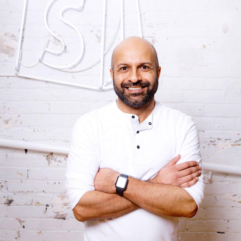 Photo of Farhan Thawar against a white wall